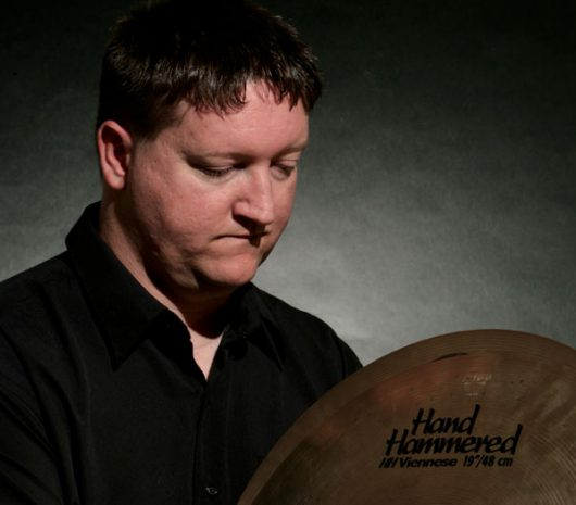 Tracy Wiggins playing cymbals
