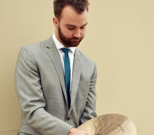 Travis Houston playing cymbals