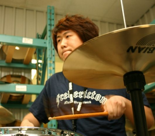 Xun Liang playing cymbals